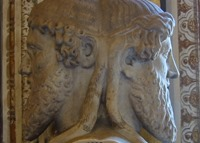 """Janus: """"The god of beginnings and transitions,[1] and thereby of gates, doors, doorways, passages and endings. He is usually depicted as having two faces, since he looks to the future and to the past."""""""