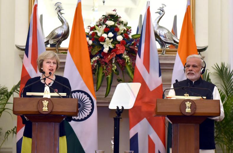UK & India PMs talk bilaterally, with liberalising services clearly on agenda
