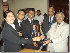 NLS Srinivasan, Parikh, and Ayyathurai (l. to r.) lift the funding round trophy